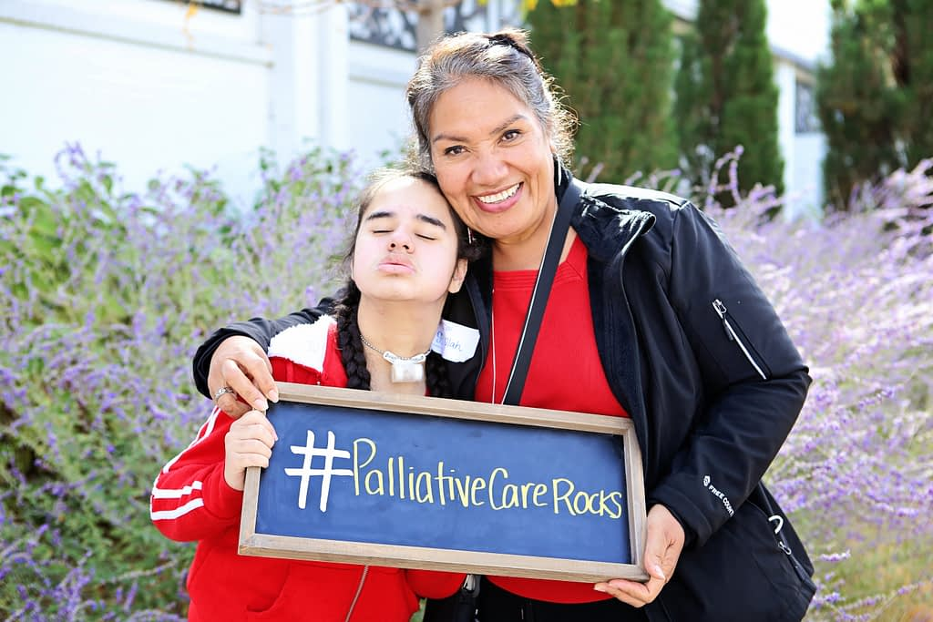 Family with palliative care sign